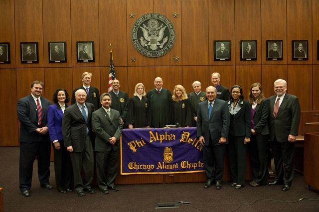 The Chicago Alumni Chapter recently initiated 8 prominent attorneys who pledged to uphold the fraternity's mission of service to the student, the school, the profession and the community. The new initiates are in the front row, l to r:  Daniel Cotter; Jayne Reardon; Edward Andersen; Enrique Abraham, President of the Puerto Rican Bar Association; Mark Hassakis, President-Elect of the Illinois State Bar Association; Yolaine Dauphin; Laura Milnichuk; Alfred Swanson, Jr. Back row, l to r: Kevin Hull, Pierre Priestley, Nicole Kopinski, Chief Judge Holderman, Michele Jochner, Bob Downs, John Norris.