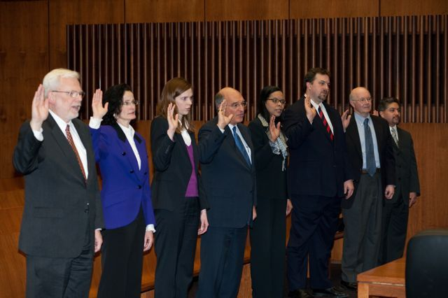 The new initiates take the oath of membership.