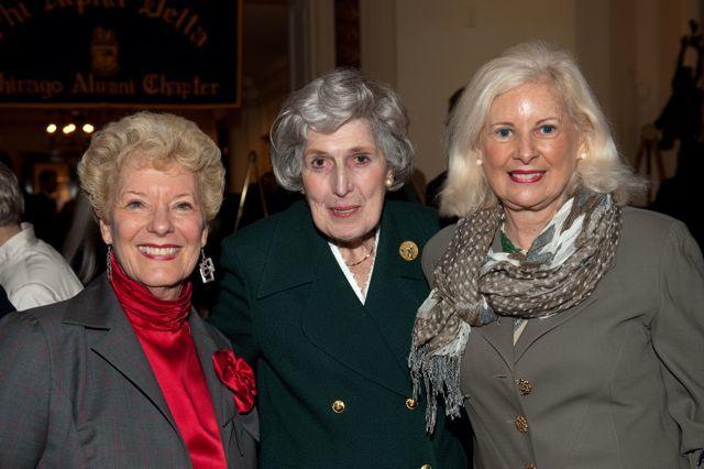Past ISBA President Hon. Carole K. Bellows and Hon. Rhoda Davis Sweeney congratulate Justice McMorrow.