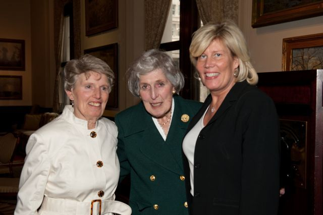 Justice McMorrow is congratulated by her sister, Frances Grohwin, and her daughter, Dr. Mary Ann McMorrow.