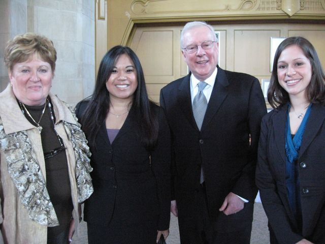 Click to enlarge: Justice Susan F. Hutchinson, law student Nhu, ISBA President John O'Brien and law student Jamie Esser