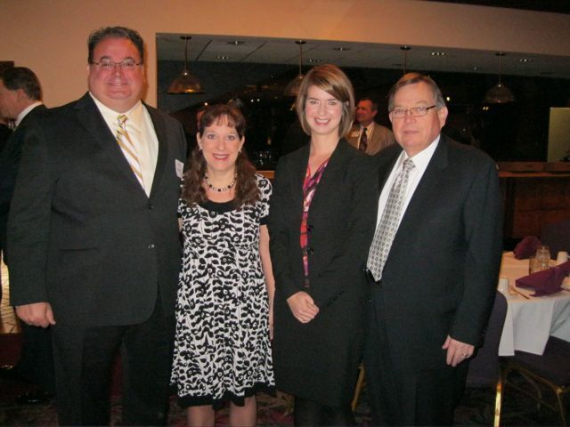 Kevin T. Hoerner, president of the St. Clair County Bar Association; Judge Julie Keehner Katz, chair of the organizing committee; Jamie Bracewell and Russell K. Scott, members of the ISBA Board of Governors. Scott is St. Clair Co. Bar Law Day Chair, and emcees the breakfast, attended by several hundred lawyers, judges, and community members.
