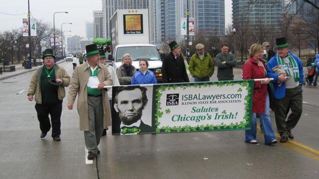 Participants march down Columbus Drive