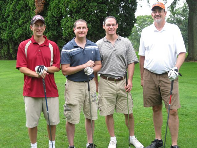 A foursome from Hinshaw Culbertson includes Jerry Barenbaum, Michael Iasparro, Matthew Hevrin and Jeff Spears