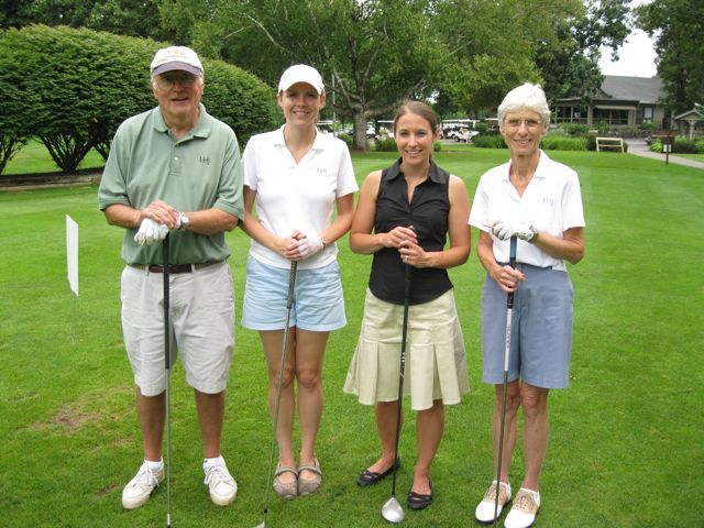 Keith (left) and Nancy Hyzer (right) of Hyzer & Jacobs are joined by more recent golfers Kaycee and Emily Chadwick