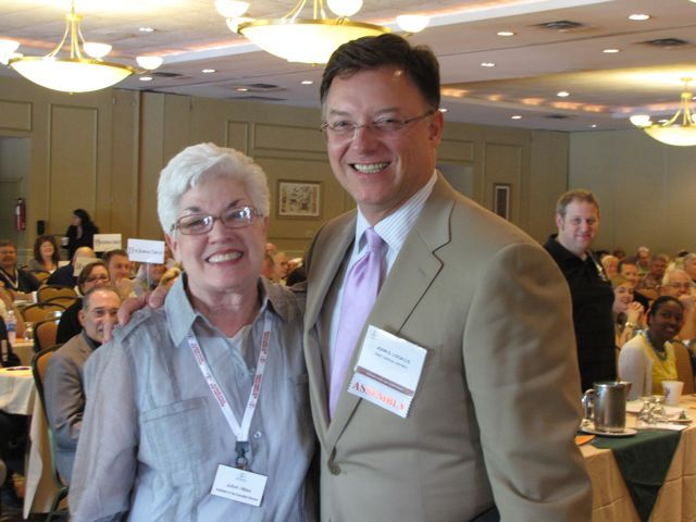 ISBA President John G. Locallo with ISBA Executive Assistant JoAnn Hibbs, who was honored for her 34 years of service to the Association.