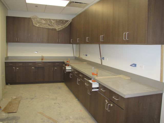 Cabinets and counters are nearly complete in the copy/mail room.