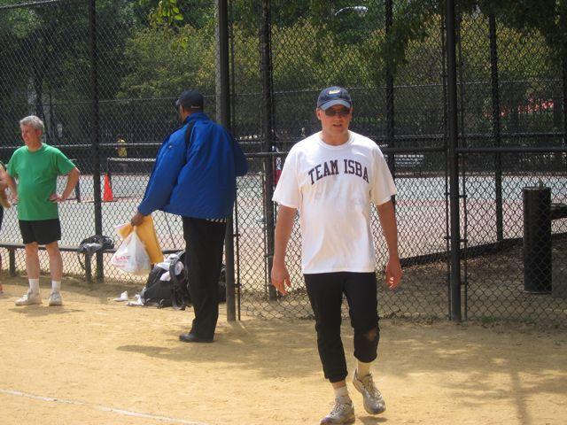 ISBA President John Locallo takes his turn at bat
