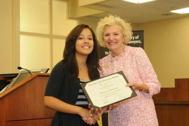Cheyenne Quinones receives a Certificate of Completion from Justice Burke