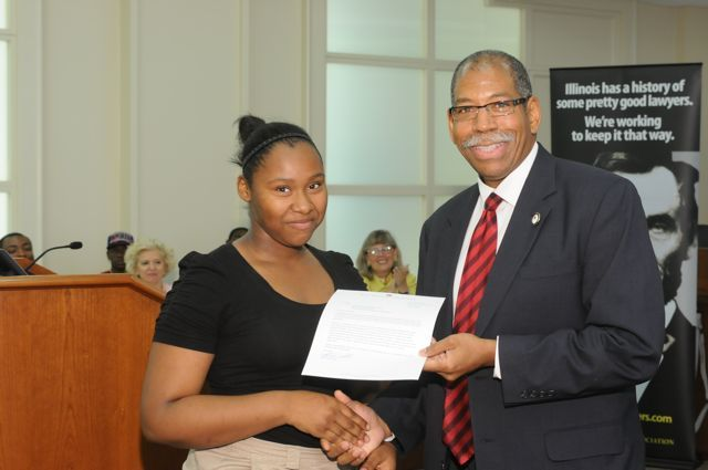Ashley Phillips receives a Moot Court Award from Dean Smith