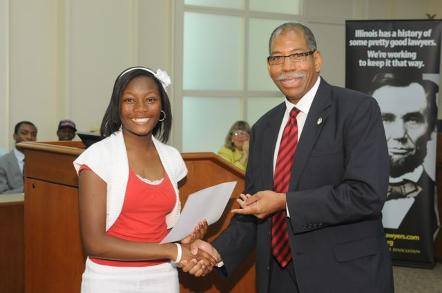 Alaya Tyler receives a Moot Court Award from Dean Smith