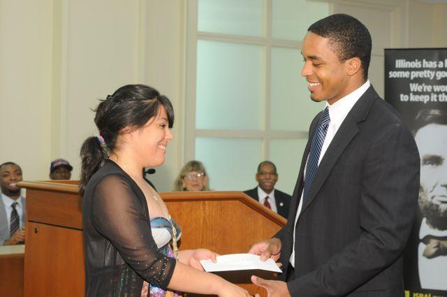 Teacher Terrance Garmon presents the Lincoln Award ($150 cash, $5,000 John Marshall tuition waiver) to Esperanza Gaytan