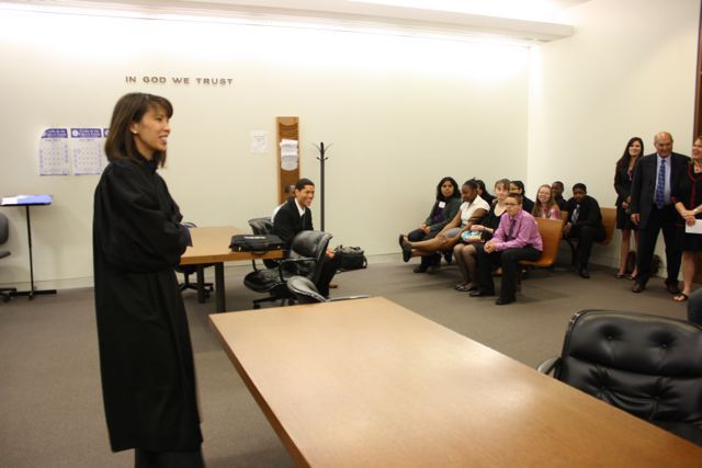 Judge Liu speaks with the students.