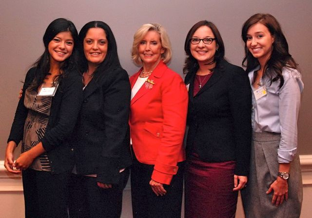 Noemy Garcia (far Left) and Emily Masalski (second from right) of the ISBA's Women and the Law Committee greet Lilly Ledbetter