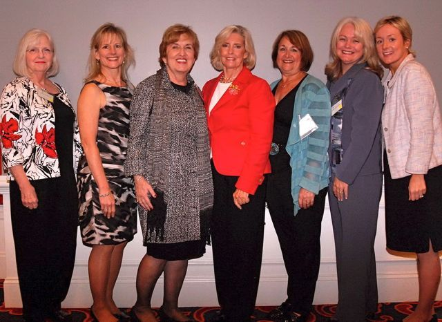 Sandra Crawford (second from right), immediate past Chair of the ISBA Women and the Law Committee, and friends greet Lilly Ledbetter.
