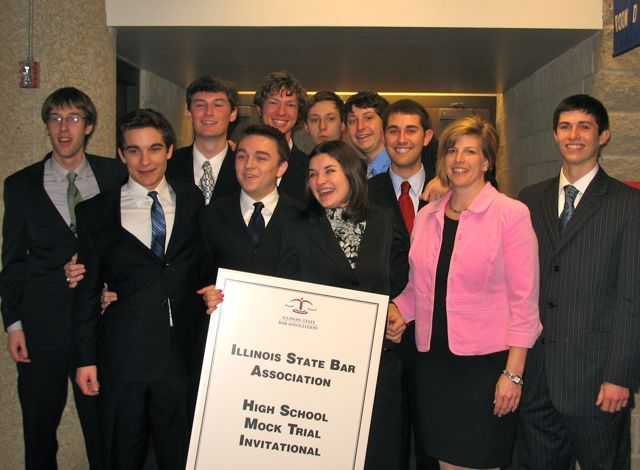 The winners of the 2011 ISBA High School Mock Trial Invitational, Chatham Glenwood High School. Front (left to right):  Ben Shane, Samuel Adkisson, Kelly Franklin, Coach Christine Self, Zane Carmean; Back (left to right):  Jansen Eaton, Luke Folkerts, Travis Farris, Tylar Midden, Skylar Midden, Quinn Marschik