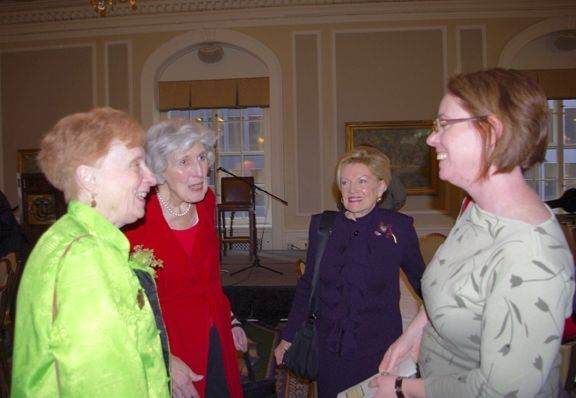 Judge Muphy is congratulated by Justice McMorrow, Janet Piper Voss (Executive Director of LAP), and Judge Murphy's daughter, Brigid Wolff.
