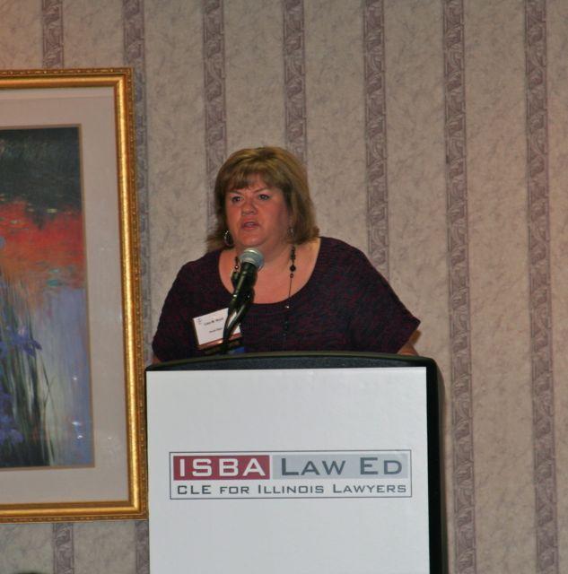 ISBA Board member Lisa Nyuli introduces Chief Justice Kilbride