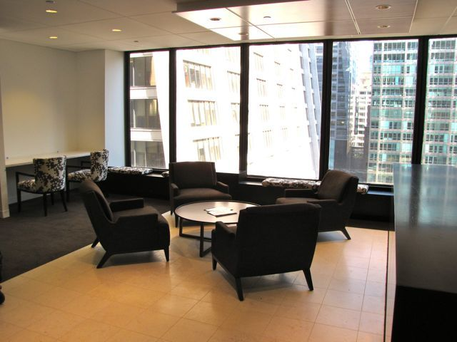 Main lobby and reception area with member workstations at left