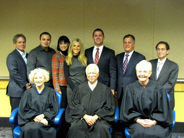 New admittee Jason Fisher and family with Justices Burke, Freeman and Theis
