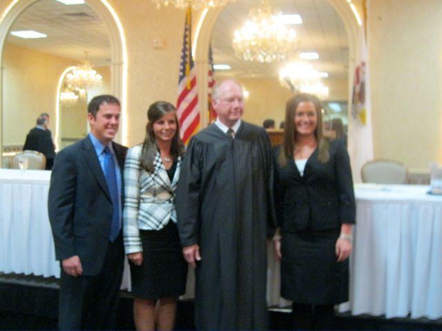New admittees Arynn Wassel and Ryne Takacs, Chief Justice Thomas L. Kilbride and new admittee Allison VanNatta.