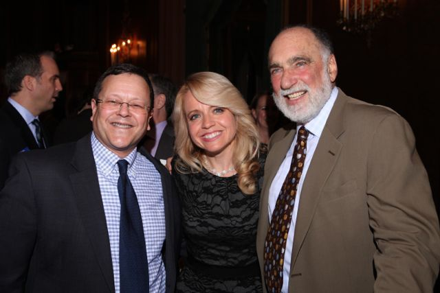 Michele Jochner (center) is congratulated by Jonathan Lowe and Warren Lupel.