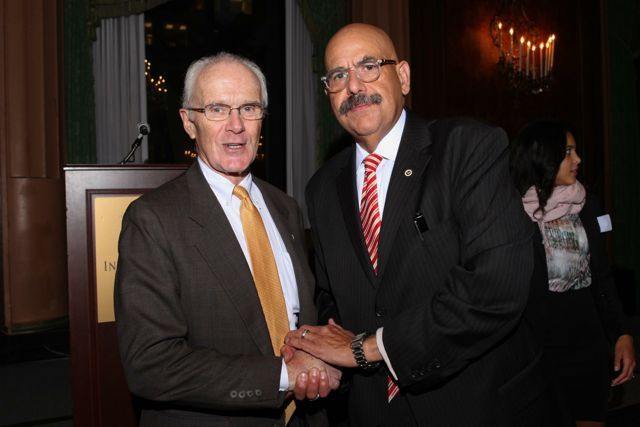 Attorney John Lowrey congratulates awardee Hon. William Hooks.