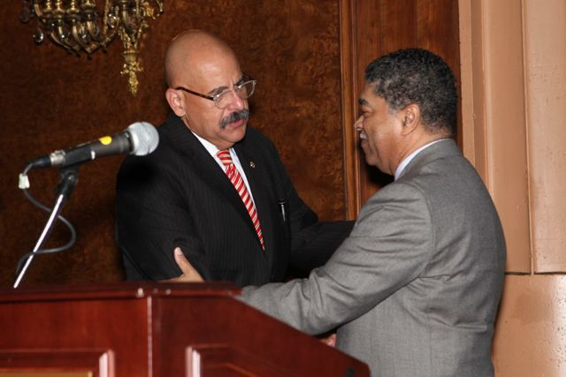 Chief Judge Timothy Evans congratulates Judge William Hooks after introducing him.