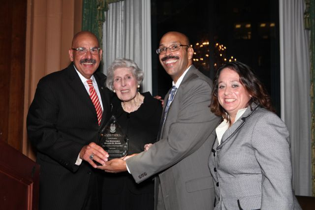 Judge William H. Hooks receives the award from its namesake, Justice Mary Ann G. McMorrow (Ret.), PAD Chicago Alumni Chapter Justice Pierre W. Priestley and Deidre Baumann, Chair of the event.