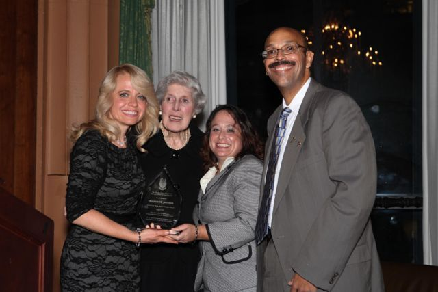 Michele Jochner receives the award from its namesake, Justice Mary Ann G. McMorrow (Ret.), Event Chair Deidre Baumann, and  Pierre W. Priestley, Justice of the Chicago Alumni Chapter of Phi Alpha Delta.