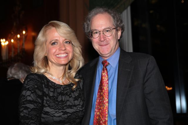 Michele Jochner is congratulated by Dean Gregory Mark of DePaul University College of Law, her alma mater.