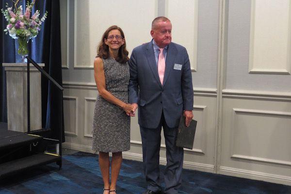 Dean Jennifer Rosato Perea, Board of Governors Award recipient,and President Russell Hartigan