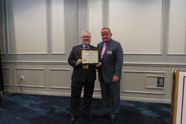 Curtis Ross, Presidential Commendations Award recipient,and President Russell Hartigan