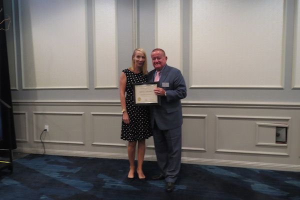 Jessica Hegarty, Presidential Commendations Award recipient,and President Russell Hartigan