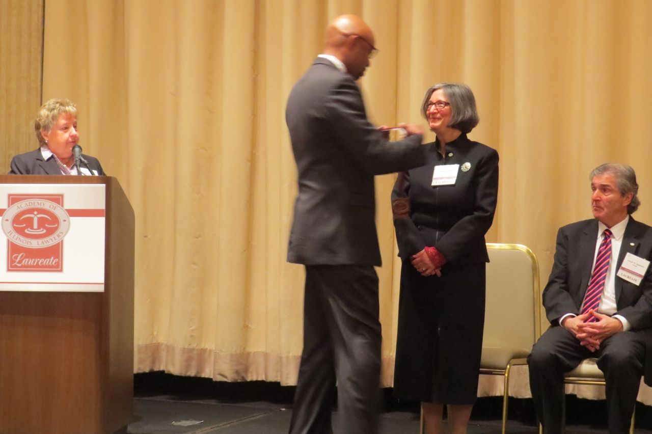Vincent Cornelius awards Patricia Bronte with her award