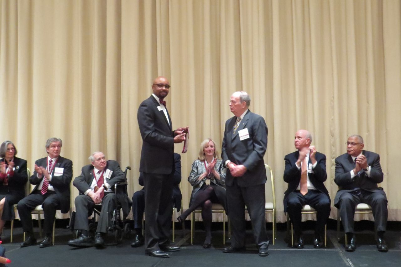 Vincent Cornelius presents Nicholas Motherway his award