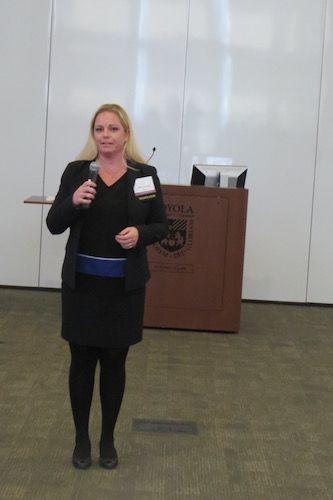 Julie Johnson delivering introductory remarks