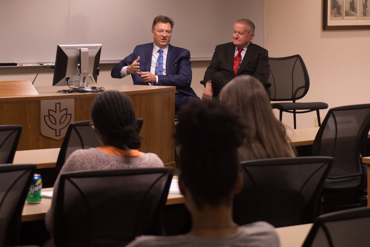 John Locallo and Judge Hartigan speak to an audience of law school students at ISBA Day at DePaul University College of Law.