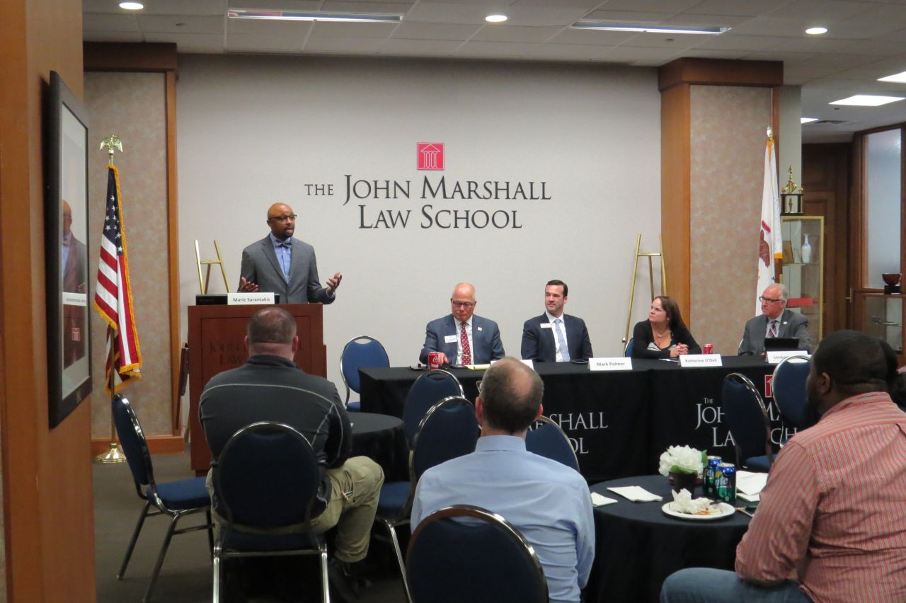ISBA President Vincent Cornelius, James McCluskey, Mark Palmer, Katherine O'Dell, and UmbertoDavi speak to an audience of law studentsat ISBA Day at the John Marshall Law School.