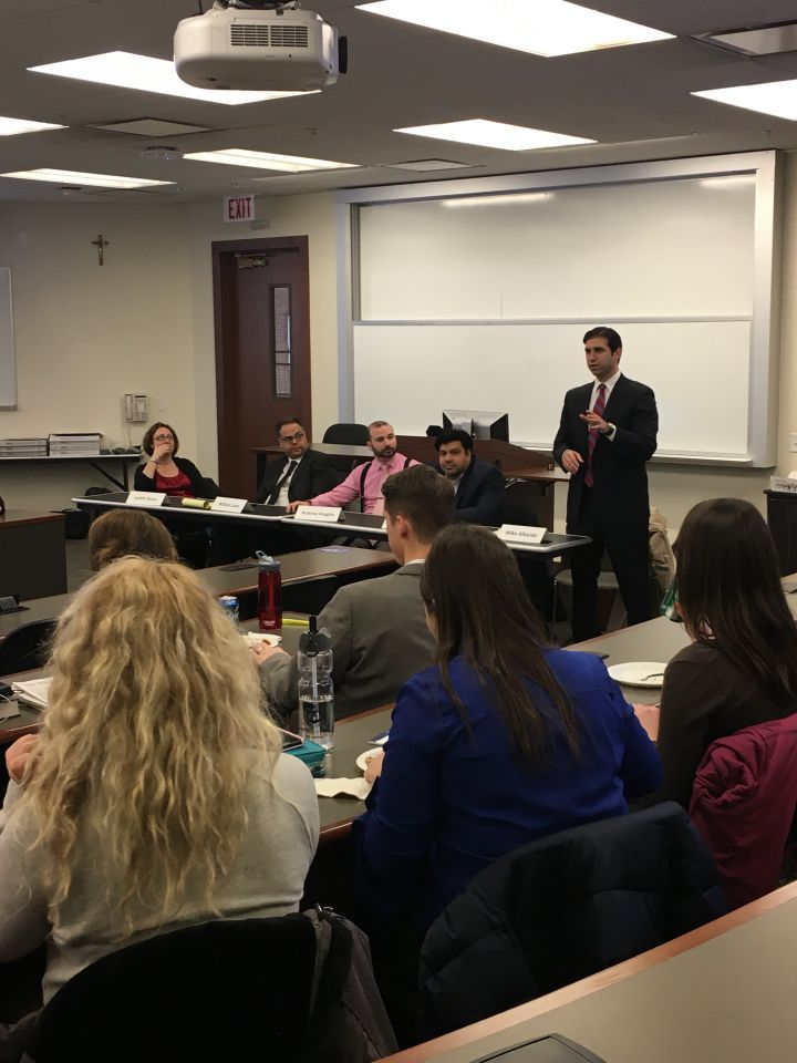 Moderator Mike Alkaraki and panelists speak to an audience of law students atISBA Day at Loyola University Chicago School of Law.