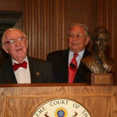 Justice John Paul Stevens accepts a replica of the Abraham Lincoln bust the ISBA commissioned for the Lincoln bicentennial from ISBA President Jack Carey.