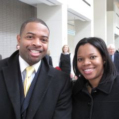 James Liggins, a Michigan state graduate admitted to the bar on Thursday, with his wife, Jyllian