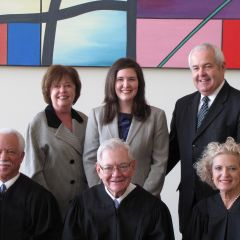 Front row: Justices Freeman, Fitzgerald and Burke. Back row: ISBA member Al Durkin (right) with his wife, Kathy, and daughter Jessica, who was admitted to the bar on Thursday.