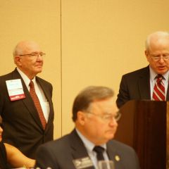 Supreme Court Justice Lloyd Karmeier (middle) listens as IJA President Ronald D. Spears (right) presents the Founders Award to ISBA past president Richard L. Thies.