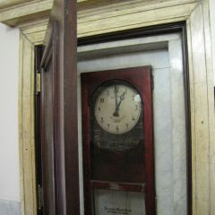 Antique wall clock on the first floor