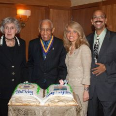 Justice Mary Ann G. McMorrow, Michele Jochner and Pierre Priestley congratulate Judge Leighton on his 97th birthday.