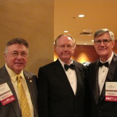 Alan Pearlman (left), State Supreme Court Justice Thomas Kilbride and U.S. Central District Chief Judge Michael McCuskey attend the Opening reception.