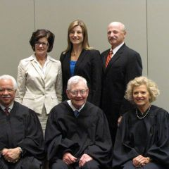 New admittee Colleen DeRosa and family with the justices.