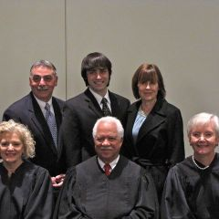 New admittee Michael Pellegrino with his father, ISBA member Richard Pellegrino, his mother and the justices.
