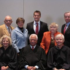 New admittee Kevin Sterk with his family and the justices.
